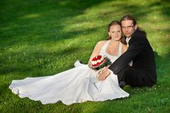 Newlyweds in the park Stock Photography