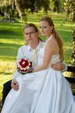 Newlyweds in the park Royalty Free Stock Photo