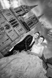 Newlyweds posing in city black and white Stock Photo