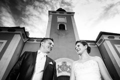 Newlyweds posing in front of Lukavec castle bw Stock Photo