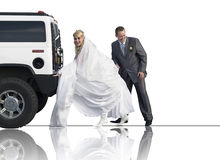 Newlyweds pushing a limousine Royalty Free Stock Images