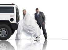 Newlyweds pushing a limousine royalty free stock images