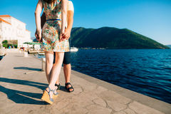Newlyweds on the quay. Legs close-up. Wedding in Montenegro Royalty Free Stock Photos