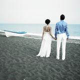 Newlyweds at the sea stock photos