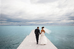 Newlyweds on the sea berth. Royalty Free Stock Photography