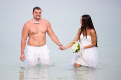 Newlyweds at sea Stock Photo