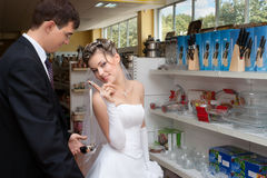 Newlyweds shopping kitchen utensils Stock Photos