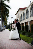 Newlyweds on sidewalk Royalty Free Stock Photo