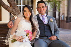 Newlyweds sitting on a bench Royalty Free Stock Image