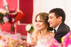 Newlyweds  sitting together. Celebration, wedding reception in a restaurant. Royalty Free Stock Photo