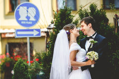 Newlyweds smile standing on a kiss place Royalty Free Stock Images