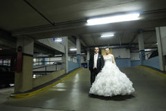 Newlyweds standing in garage Stock Photography