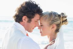 Newlyweds standing by the sea face to face Stock Images