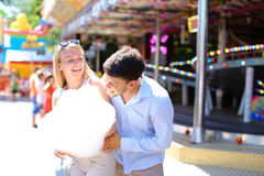 Newlyweds strolling in luna park, looking at each other, cuddlin Royalty Free Stock Photo