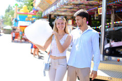 Newlyweds strolling in luna park, looking at each other, cuddlin stock photo