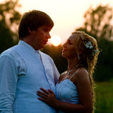 Newlyweds at sunset Stock Photography