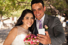 Newlyweds taking selfie Stock Photo