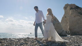 The newlyweds talk and spend time together near the ocean stock video footage