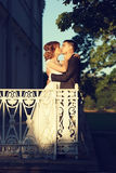 Newlyweds at terrace Royalty Free Stock Images