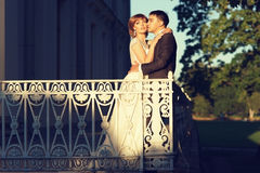 Newlyweds at terrace Royalty Free Stock Image