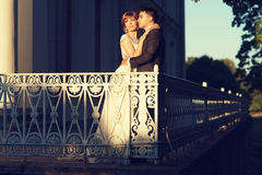 Newlyweds at terrace Stock Photography