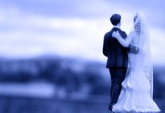 Newlyweds on their backs with unfocused background. Standard figure without defined author stock image