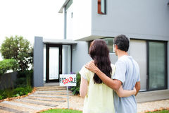 Newlyweds with their new house Stock Photography