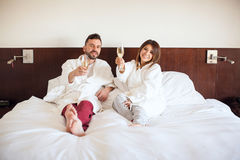 Newlyweds toasting with champagne Royalty Free Stock Photography