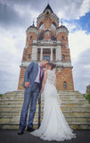 Newlyweds and Tower Gardos Royalty Free Stock Photography