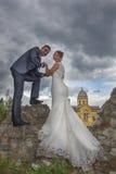 Newlyweds and Tower Gardos Stock Photo