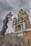 Newlyweds and Tower Gardos Stock Images