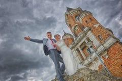 Newlyweds and Tower Gardos Royalty Free Stock Photo