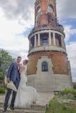 Newlyweds and Tower Gardos Stock Image