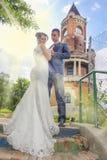 Newlyweds and Tower Gardos Stock Photos