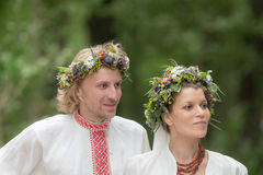 Newlyweds in traditional russian dress Stock Photos