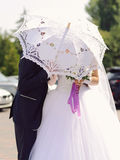 Newlyweds under Umbrella Stock Images