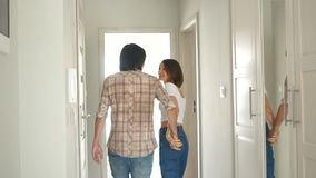 Newlyweds visiting their new apartment. Man and woman are very happy, real estate concept, happy family stock video