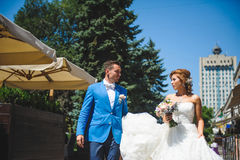 Newlyweds Walking in City. At sunny day Stock Image