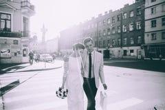 Newlyweds walking down the street. Royalty Free Stock Photo