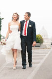 Newlyweds walking in the street. stock photography