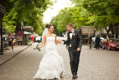 The newlyweds are walking on the street. Stock Image