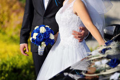 Newlyweds with wedding blue rose bouquet Royalty Free Stock Image