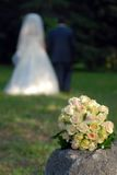 Newlyweds, Wedding Bouquet And Stone Royalty Free Stock Images