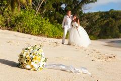Newlyweds with wedding bouquet Stock Photos