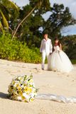 Newlyweds with wedding bouquet Stock Images