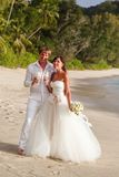 Newlyweds with wedding bouquet Stock Photo