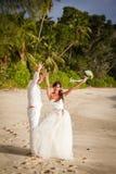 Newlyweds with wedding bouquet Royalty Free Stock Image