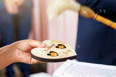 The priest sanctifies the wedding rings of the newlyweds in the church royalty free stock photo