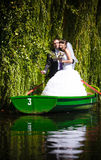 Newlyweds in willows Royalty Free Stock Photo