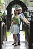 Newlyweds on wooden bridge Stock Images